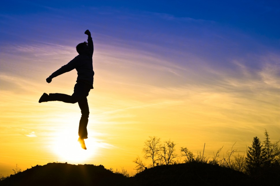 Man jumping in air sunset